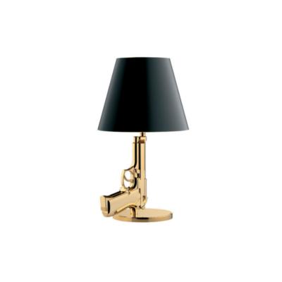 Flos Bedside Gun pöytävalaisin Philippe Starck